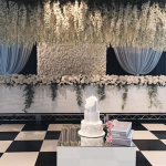 White flower wall behind bridal table 2
